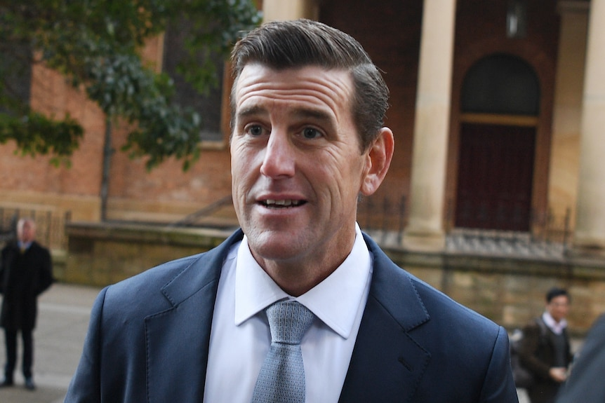 Ben Roberts-Smith wears a suit and tie as he arrives at the NSW Supreme Court.