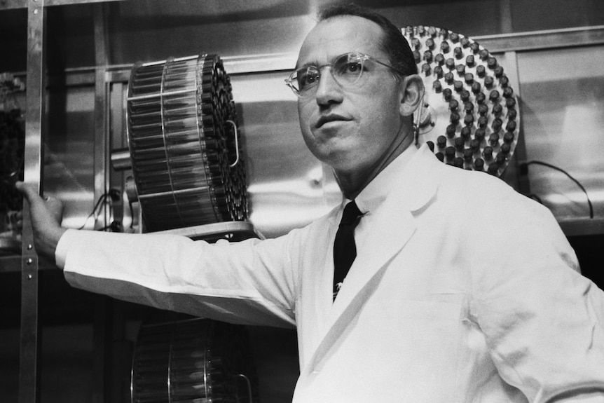 DrJonas Salk stands in the University of Pittsburgh laboratory in which he developed a vaccine for polio.