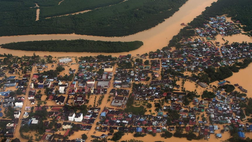This aerial view shows houses and plantations submerged in floodwaters in Pengkalan Chepa, near Kota Bharu on December 27, 2014