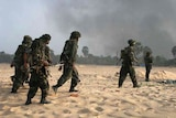 Sri Lankan soldiers advance during the civil war with the Tamil Tigers.