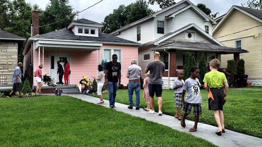 Mourners walk to and from Muhammad Ali's childhood home.