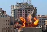 The al-Jalaa building used by AP and Al Jazeera in flames after being hit by an Israeli strike.