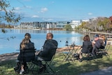 Canberrans enjoy a drink from a temporary bar set up beside Lake Burley Griffin.