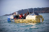 Picture of the crew rowing on the water.