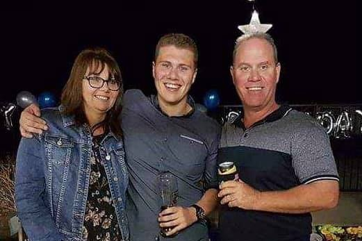 Sharon, son Jack and David Masters stand together at a social event.