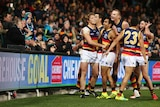 Eddie Betts celebrates in front of Port Adelaide fans