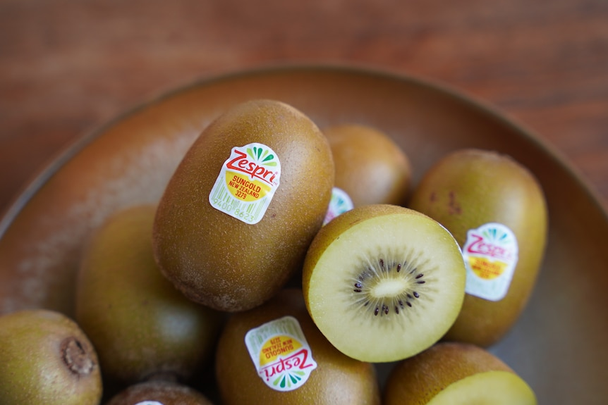 A plate of gold kiwifruits with the Zespri label visible.