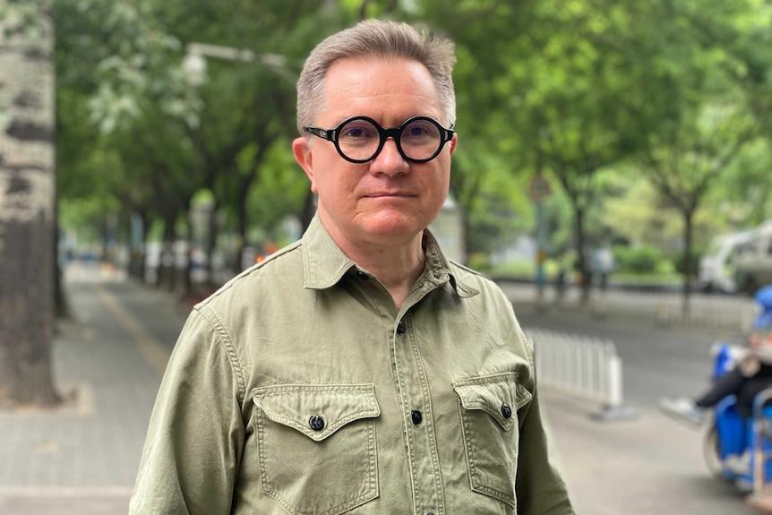 New York Times reporter Chris Buckley standing on a street in Beijing