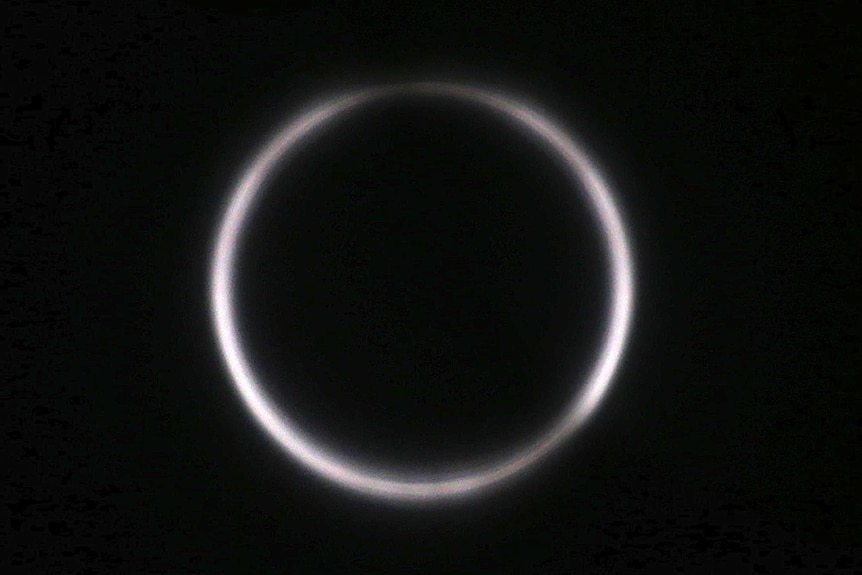 A solar eclipse is seen though Astro Solar glass in Chiayi City, southwest of Taiwan, Sunday, June 21, 2020.