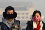 People wear face masks in Beijing