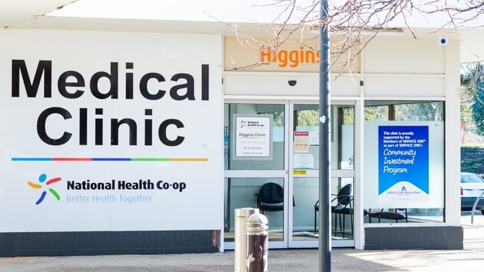 A simple medical clinic on the corner of a suburban street.