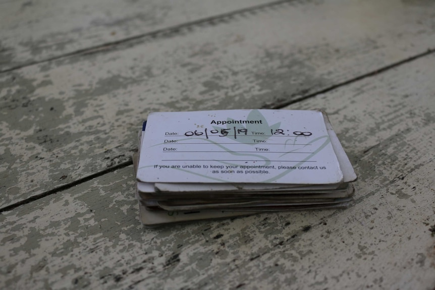 A stack of business cards on a table.