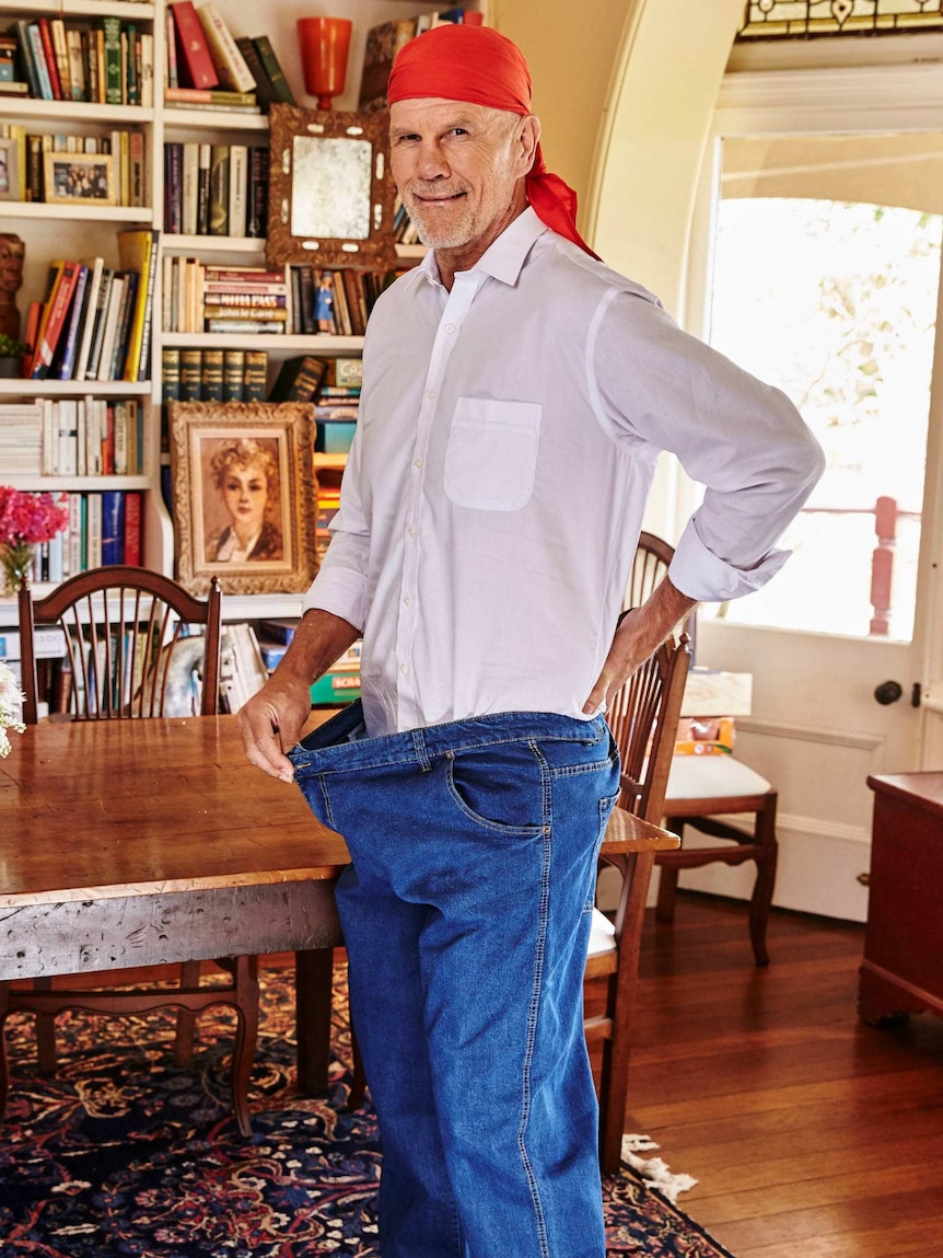 Peter FitzSimons shows how big his old jeans were.