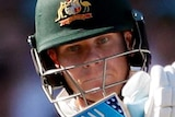Steve Smith plays a ball with a horizontal bat just under his eye line