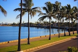 Palm trees line the picturesque waterfront at Carnarvon in morning light