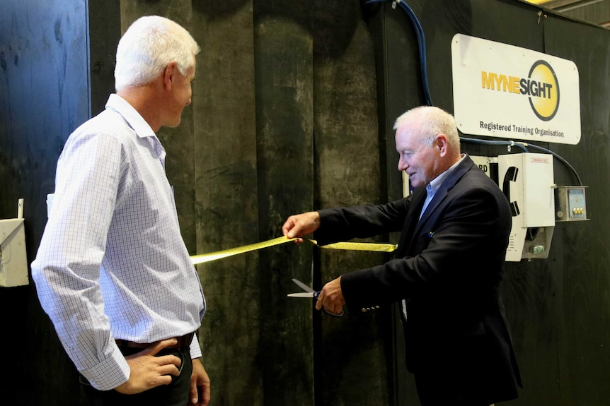 Wollongong Lord Mayor Gordon Bradbery cutting the ribbon on a new mine training facility in Cringila