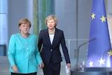 Angela Merkel and Theresa May.