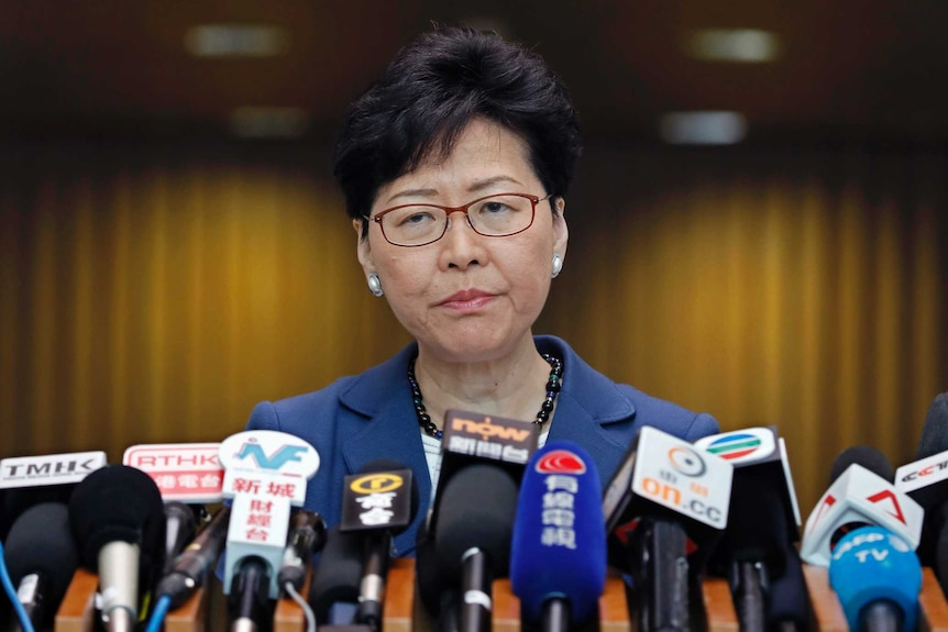 Hong Kong chief executive Carrie Lam listens to reporters' questions during a press conference.
