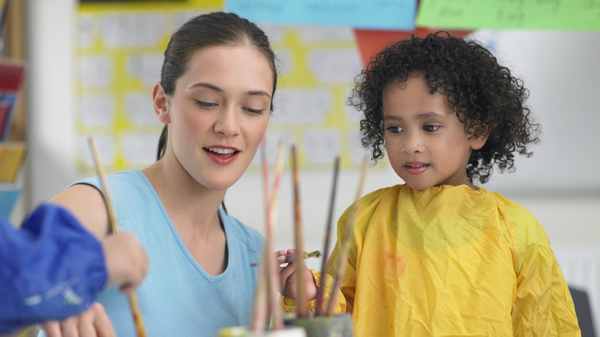 Teacher and child in a classroom