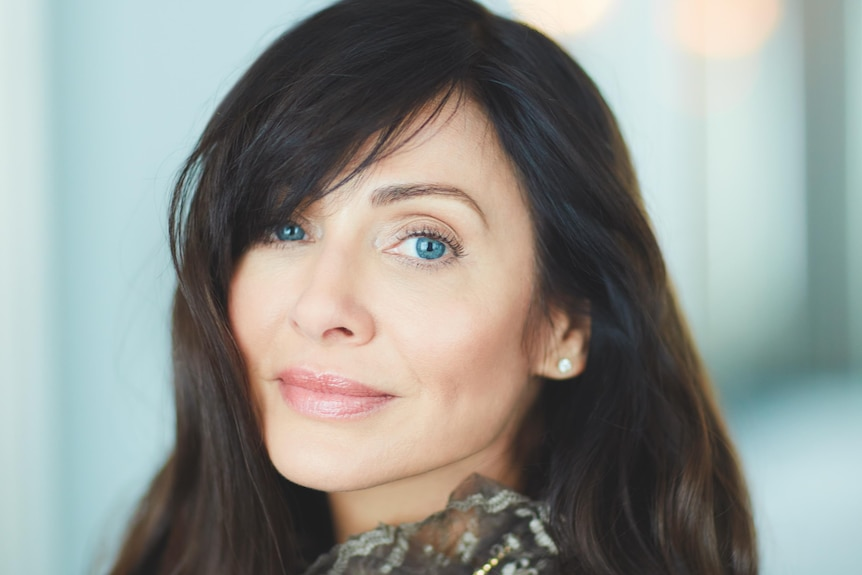 Natalie Imbruglia pictured in a portrait shot smiling.