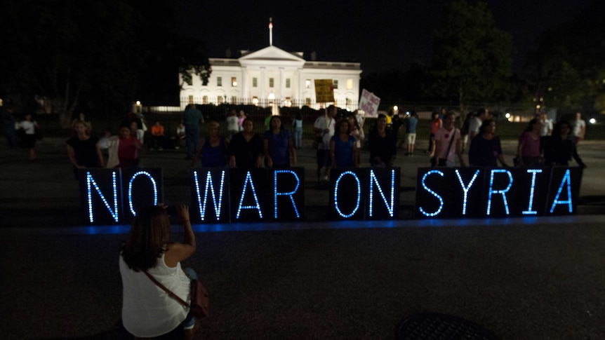 Syria protest Anti-war protesters hold vigil outside the White House