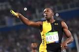 Bolt celebrates after Jamaica wins the men's 4x100m relay