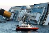 A rescue boat circles the Costa Concordia