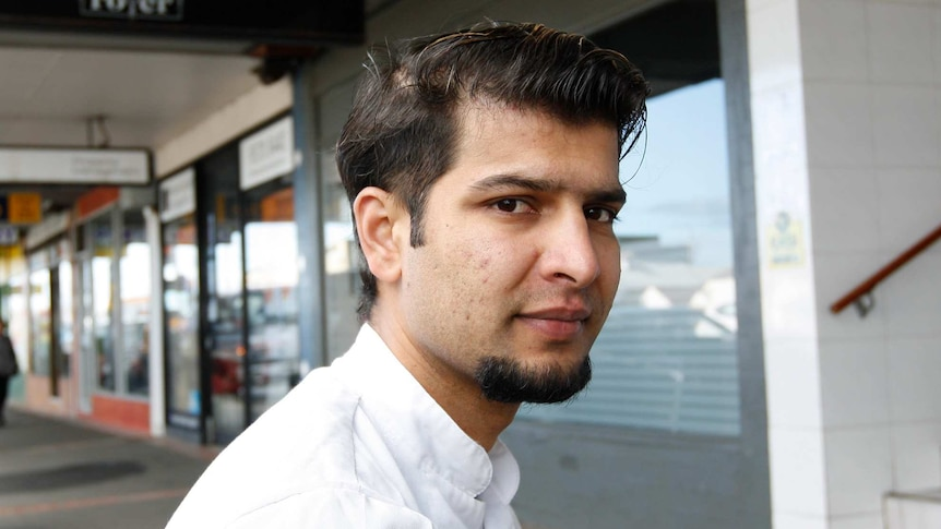Ghana Shyam Timilsina on a busy sidewalk in Melbourne, for a story on temporary visa holders, coronavirus and JobKeeper.
