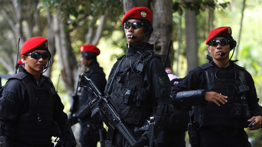 Members of the Indonesian Army's Kopassus special forces patrol.