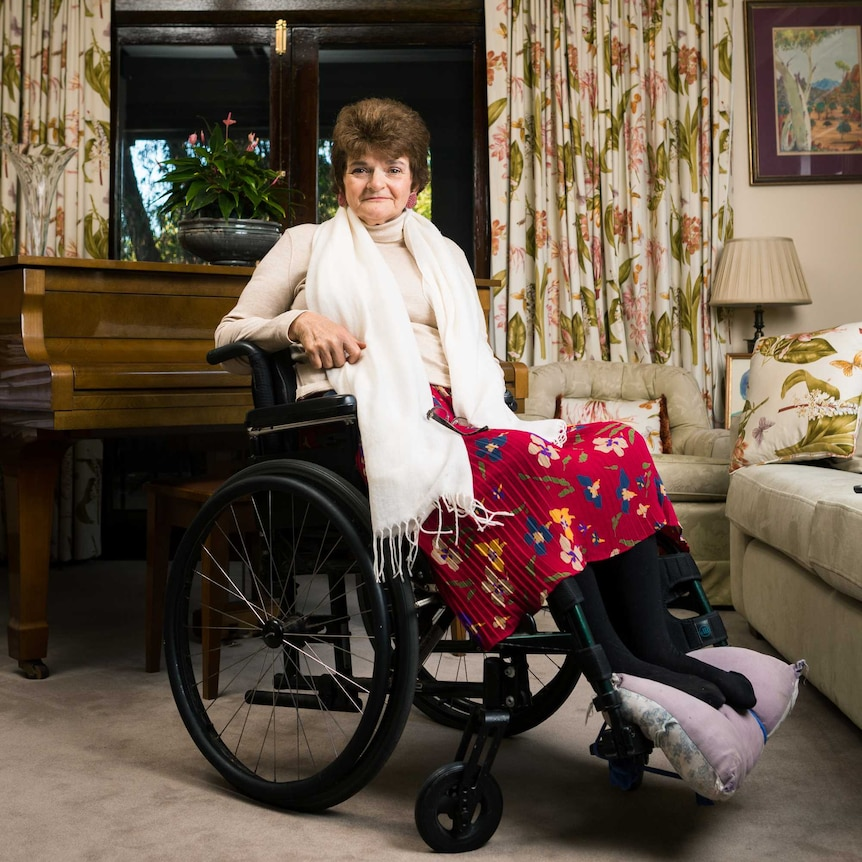 Woman in wheelchair in loungeroom