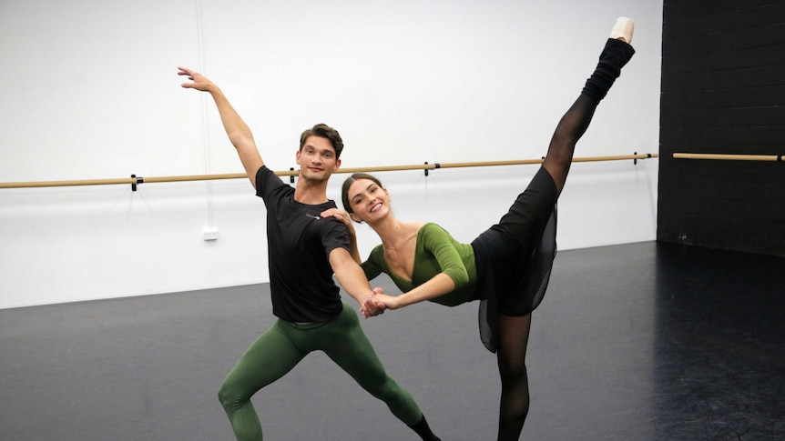 A male and female ballet dancer strike a pose.
