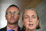 The Greens senator Lee Rhiannon (R) and leader Richard Di Natale stands behind her.