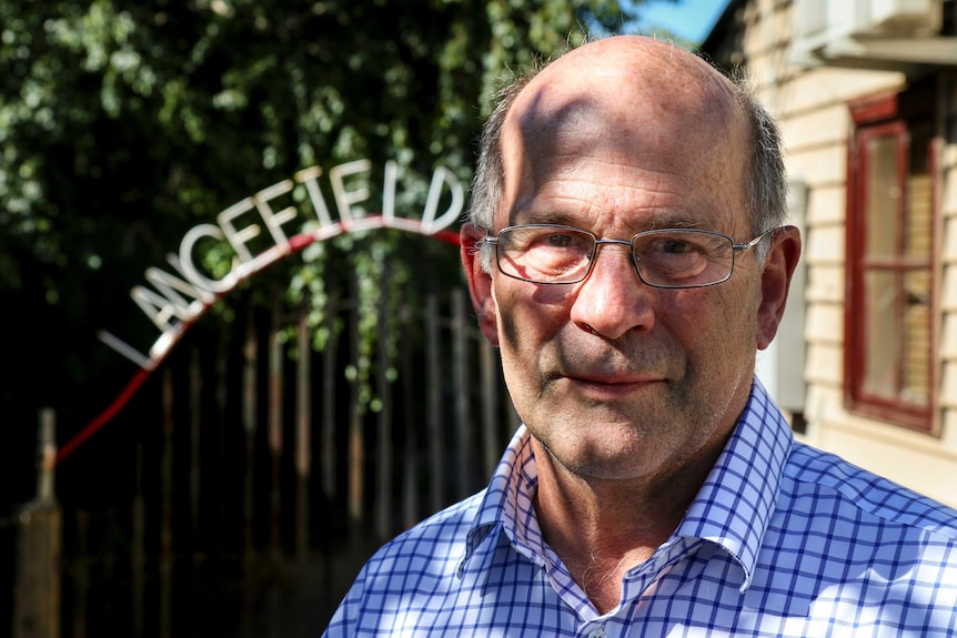 Dr Paul Carter stands in front of a Lancefield sign.