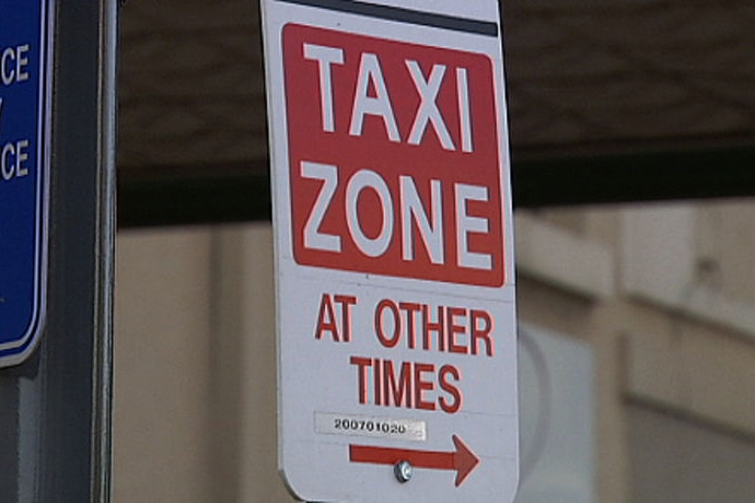 A sign of a taxi parking zone