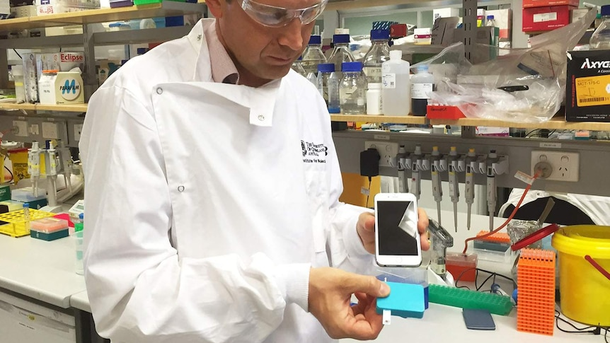 Professor Kirill Alexandrov with an earlyprototype of a diagnosticdevice.