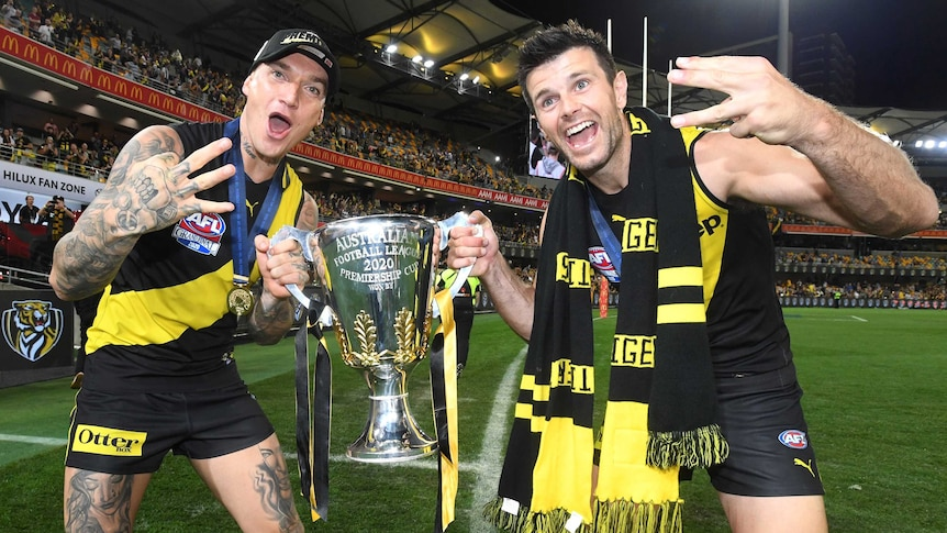 Dustin Martin and Trent Cotchin hold the AFL trophy while doing a lap of honour after the grand final win over Geelong