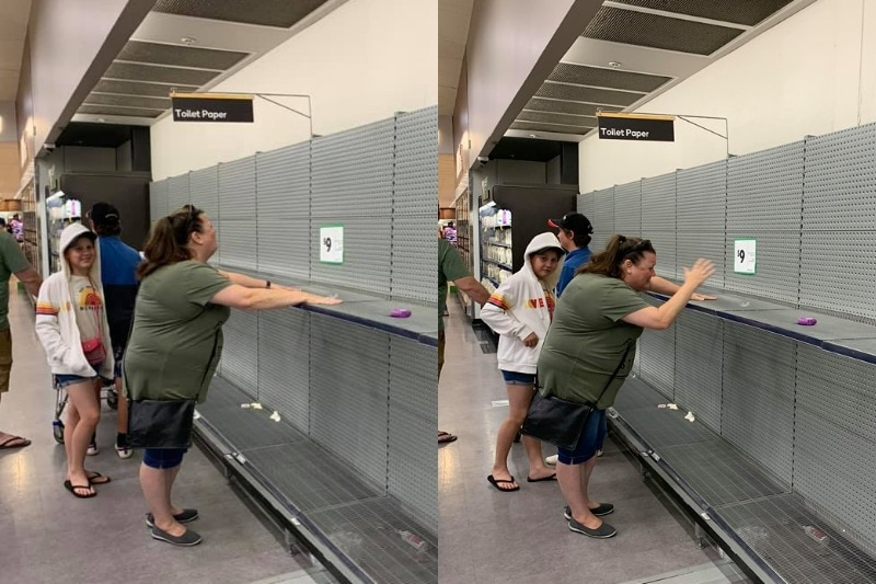 A woman looks sad at the sight of the empty shelves, a sign says 'toilet paper.'