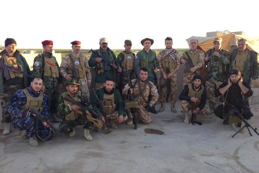 Khamis Gewargis Khamis with militia fighters in northern Iraq