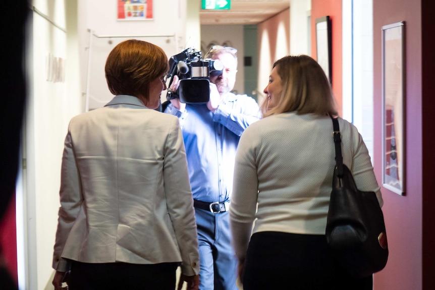 Meegan Fitzharris walking out of ABC studios in Canberra