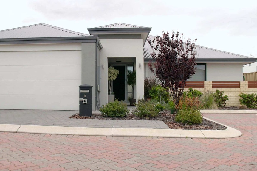 An exterior shot of a grey single-storey home.