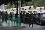 Chinese paramilitary police prepare to ride armoured vehicles through Urumqi, Xinjiang, China.