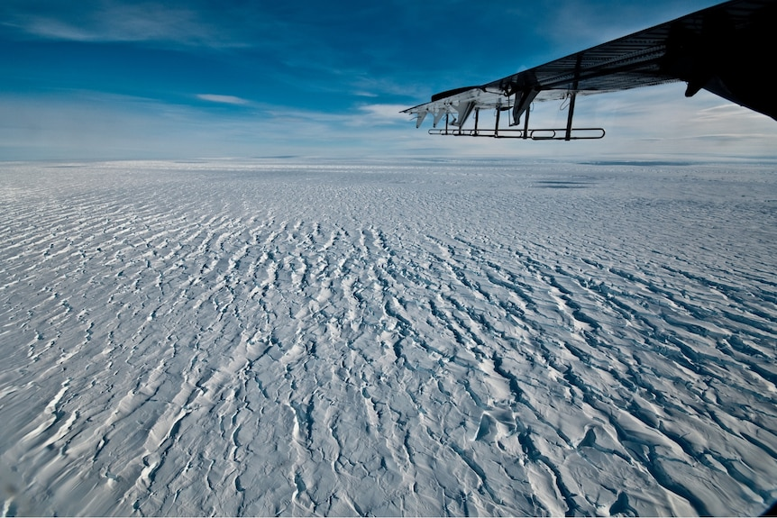 View out a plane of a huge expanse of ice.