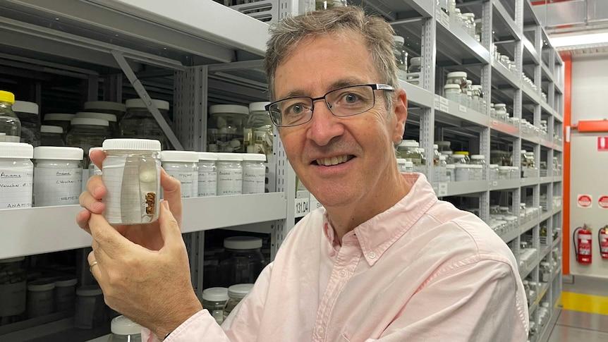 Dr Mark Harvey holding a specimen from the Anamidae family.