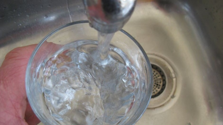 Water filling up a glass.