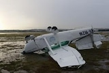 An overturned aircraft at Archerfield Airport