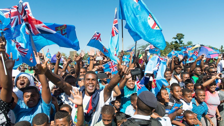 Fans greet Fiji's Olympic gold-medal-winning men's sevens rugby team.
