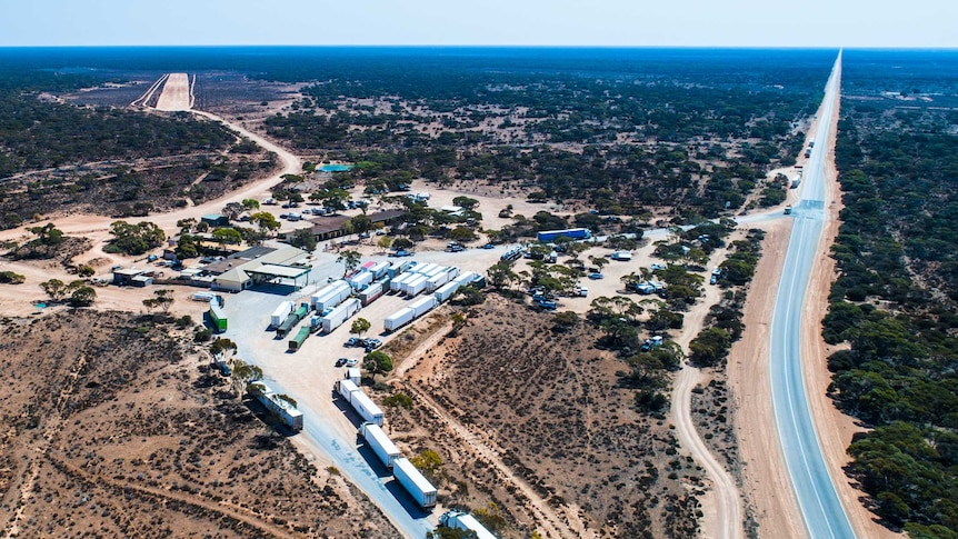 A drone photograph of a remote roadhouse on the Nullarbor