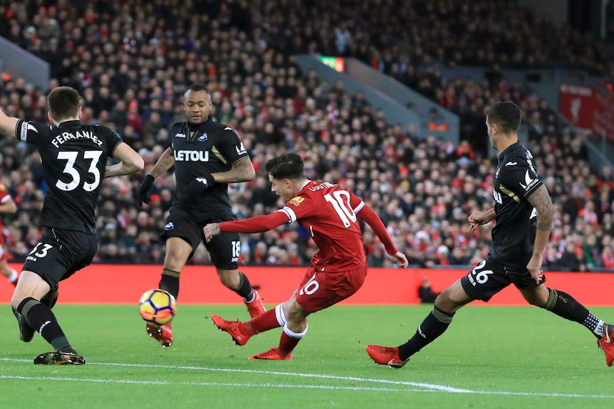 Philippe Coutinho scores for Liverpool against Swansea