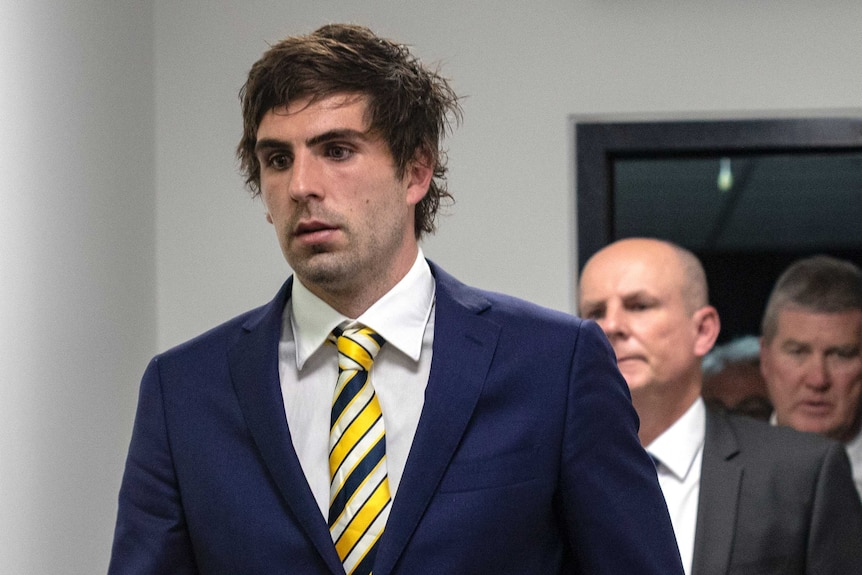 Andrew Gaff walks out of the AFL tribunal after being suspended for punchin Andrew Brayshaw.