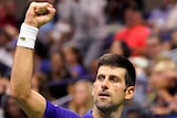 Novak Djokovic holds his fist in the air during a match against Jenson Brooksby at the US Open.